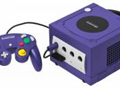 English: A Nintendo GameCube console shown with memory card and a standard controller. Note that the bottom port cover for the Game Boy Player Advance has been removed. This is the JPG version.