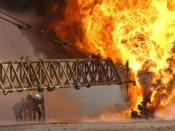 English: Kuwaiti firefighters attempt to extinguish an oil fire at the Rumaila Oilfield, Iraq as part of the coalition effort in Operation Iraqi Freedom on March 27, 2003.