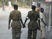 It is not unusual in many societies throughout east Africa for men to display their friendship for one another by holding hands in public. Two soldiers on patrol in the streets of Bujumbura, Burundi nonchalantly express their affection for one another.