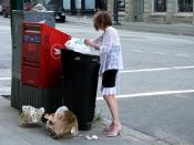 English: A poor woman going through the garbage, in search of anything valuable. Seen in the Gastown tourist area, of the ghetto downtown eastside area, in Vancouver BC Canada.