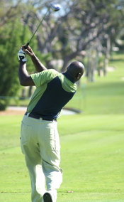 Michael Jordan following through on his golf swing in 2007.