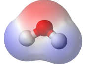 A water molecule, a commonly-used example of polarity. The two charges are present with a negative charge in the middle (red shade), and a positive charge at the ends (blue shade).