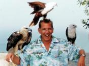 Jeff Woloson in Thailand. The birds atop Jeff's head and left arm are Brahminy Kites; the larger bird on his right arm is a young White-bellied Sea-eagle.