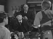 Mr. Potter slumps in his wheelchair when having to face Peter Bailey and his minor son George.