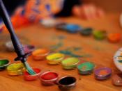 English: A palette of watercolours and a brush. Deutsch: Wasserfarben und Pinsel.