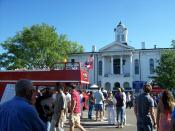 A double-decker bus passes the north side of the Lafayette County Courthouse in Oxford, Mississippi, during the 2007 Double Decker Festival.