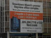 English: A large leasing sign on the One Bayfront Plaza building in Downtown Miami.