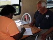 English: Weir, MS, May 8, 2010 -- Inside a new FEMA temporary housing unit in Choctaw County, FEMA Mobile Home Site Inspector Don McLemore completes the leasing process as the new tenant signs the lease. These units, provided through the FEMA Individual A