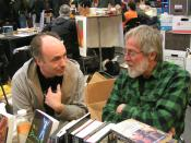 English: Lawrence Jarach and John Zerzan in discussion at the Anarchy: A Journal of Desire Armed booth, during the 2010 Bay Area Anarchist Book Fair.