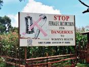 English: A campaign against female genital mutilation – a road sign near , Uganda. עברית: .מאבק נגד מילת נשים - שלט הסברה בצד הכביש, ליד קפצ'ורווה, אוגנדה