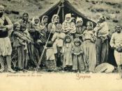 Postcard of group of gypsies in front of their tent in Smyrne