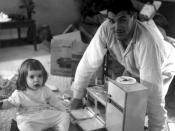 English: Father and daughter with early Easy Bake Oven, which resembled a conventional oven.