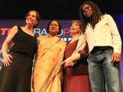 """""""We need to nurture the feminine energy in women, and men… the young men. The old men are hopeless. We have to wait for them to die off."""" -- Isabel Allende, Chilean Novelist (in red). Women in the photograph (L to R) Susan Cohen, Lakshmi Pratury, Isabel A"""