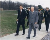 Meeting with President Eisenhower. President Kennedy, President Eisenhower, military aides. Camp David, MD. - NARA - 194198
