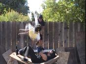 Backyard wrestlers from KHW 209 performing a razors edge onto another wrestler.