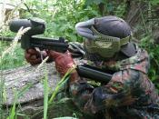 English: My bro, early in his paintball career. I'm reffing. little does he know there is a sniper aiming at his head A-5 Tippman paintball gun. Good for woodsballing this picture is backwards notice the cyclone feeder is on the wrong side
