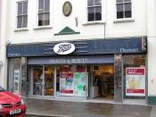 English: Boots, Omagh This shop is located at High Street and opposite Bridge Street; note the plaque above the front entrance [996123]