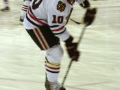 English: Patrick Sharp of the Chicago Blackhawks takes practice shots before a game against the Vancouver Canucks.