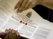 Distributing copies of the Canadian Charter of Rights and Freedoms.