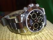 Model number 116520 stainless steel black dial Rolex Daytona.