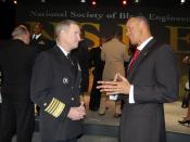 English: LAS VEGAS (March 25, 2009) Vice Chief of Naval Operations Adm. Patrick M. Walsh and Carl B. Mack, executive director of the National Society of Black Engineers, discuss the Navy's participation in the National Society of Black Engineers 35th annu