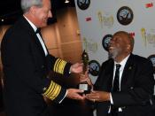 English: LAS VEGAS (March 27, 2009) Vice Adm. Jeffrey L. Fowler presents a lifetime achievement award to retired Lt. Cmdr. Wesley Brown at the National Society of Black Engineers conference in Las Vegas. Brown was honored for being the first African-Ameri