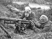 English: British Vickers machine gun crew wearing PH-type anti-gas helmets. Near Ovillers during the Battle of the Somme, July 1916. The gunner is wearing a padded waistcoat, enabling him to carry the machine gun barrel. See Image:Vickers machine gun crew