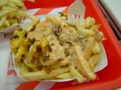 "English: ""Animal"" style fries, consisting of cheese, grilled onions, and spread on a regular order of fries at In-N-Out Burger, part of the secret menu."