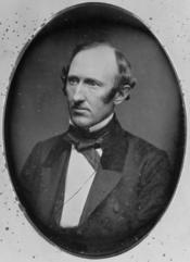 , head-and-shoulders portrait, facing left .