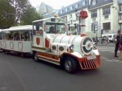 The Montmartre Bus doing the rounds near to the Moulin Rouge cabaret.