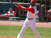 Ken hitting a large fly ball for a double in the 8th inning.