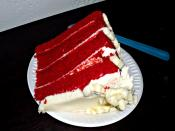 English: Photograph of a slice of a 4-layer red velvet cake with cream cheese icing on a styrofoam plate.