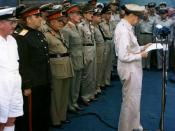 MacArthur at surrender ceremony. The flag flown by Perry is visible in the background.