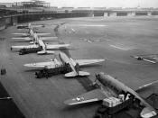 U.S. Navy Douglas R4D and U.S. Air Force C-47 aircraft unload at Tempelhof Airport during the Berlin Airlift. The first aircraft is a C-47A-90-DL (s/n 43-15672).