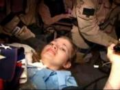 English: A combat camera video shows undated footage of U.S. PFC on a stretcher during her rescue from Iraq (USCENTCOM photo)