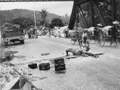 IWM caption : Royal Engineers prepare to blow up a bridge in Malaya during the British retreat to Singapore. In the background Chinese rickshaws loaded with rice from abandoned government stocks are crossing the bridge. The Allied forces under General Art