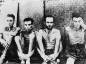 Australian and Dutch prisoners of war at Tarsau in Thailand. The four men are suffering from beri beri.
