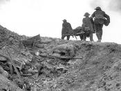 British stretcher bearers recovering a wounded soldier from a captured German trench during the Battle of Thiepval Ridge, late September 1916, part of the Battle of the Somme.