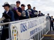 English: Mayport, Fla. (Jan. 12, 2007) - Sailors aboard the guided missile frigate USS Robert G. Bradley (FFG 49) offload 23 tons of illegal drugs seized in a multi-national and interagency effort to interdict the flow of narcotics into the United States.