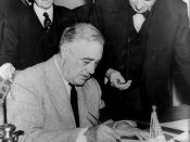 English: United States President Franklin D. Roosevelt signing the declaration of war against Germany, marking US entry into World War II in Europe. Senator Tom Connally stands by holding a watch to fix the exact time of the declaration.