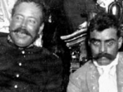 English: Emiliano Zapata and Pancho Villa during the Mexican Revolution Villa is sitting in the presidential throne in the Palacio Nacional