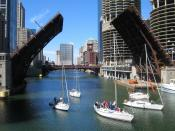 A small flotilla of boats passes through the open State Street Bridge on the Chicago River, Chicago, Illinois. Photographed from 41°53′15″N 87°37′37″W  /  °S °W  / ; latd>90 (dms format) in latd latm lats longm longs , looking west