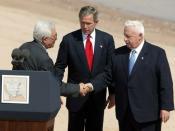 Bush, Mahmoud Abbas, and Ariel Sharon meet at the Red Sea Summit in Aqaba, Jordan, June 4, 2003.