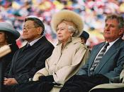 Elizabeth II (centre) with the Lieutenant Governor of Alberta, Norman Kwong (left), and Premier of Alberta Ralph Klein (right), at the official celebrations of Alberta's centenary, 23 May 2005
