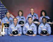 The crew of Space Shuttle mission STS-51-L pose for their official portrait on November 15, 1985. In the back row from left to right: Ellison S. Onizuka, Sharon Christa McAuliffe, Greg Jarvis, and Judy Resnik. In the front row from left to right: Michael