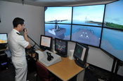 US Navy 111103-N-YX169-043 Ensign Jared Hickey, assigned to the amphibious transport dock ship USS Ponce (LPD 15), uses a voice-recognition system