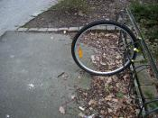 An example of theft. Someone took everything except for the front wheel.