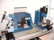 English: Training FMS with learning robot, workbench CNC Mill and CNC Lathe