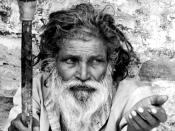 English: A man begging on the streets of Haridwar, India