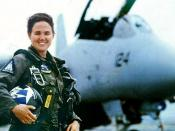 English: U.S. Navy Lt. Kara Hultgreen, the first Navy's first carrier-based combat fighter pilot, stands in front of a Grumman F-14 Tomcat. The lieutenant was killed in a Tomcat crash in 1994.